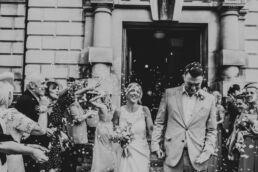bride and groom confetti tunnel
