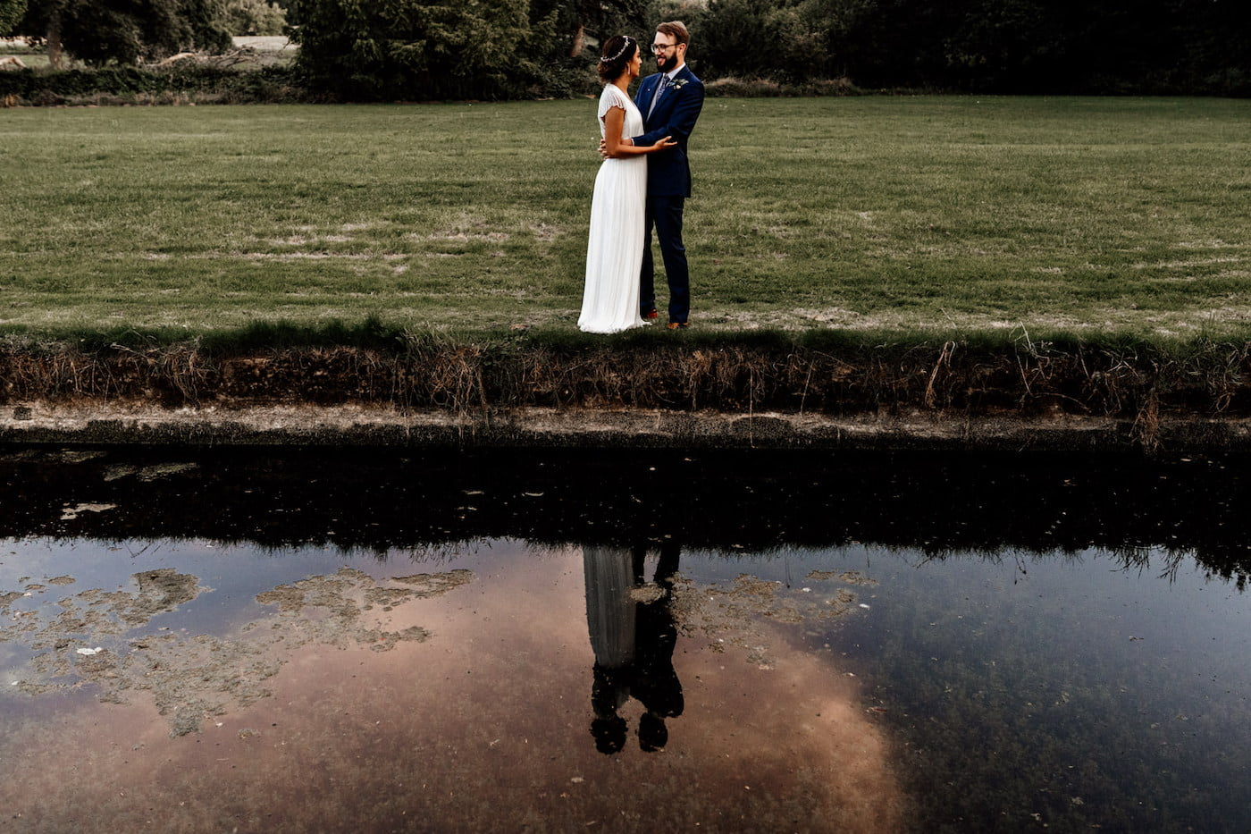 reflection photo of bride and groom