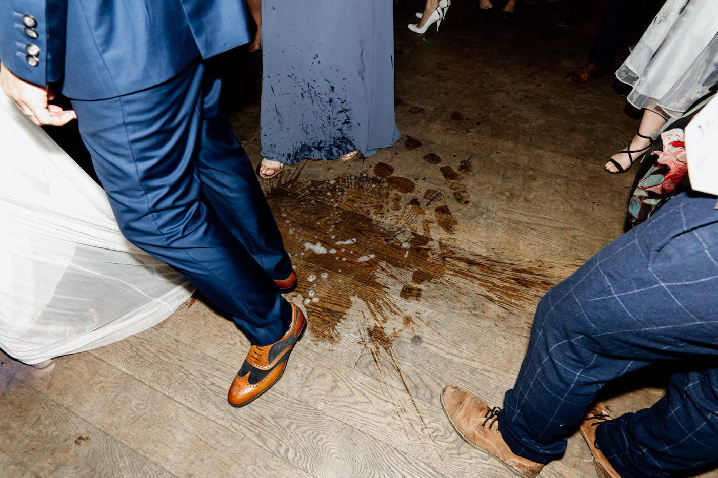 smashed glass on dance floor at wedding