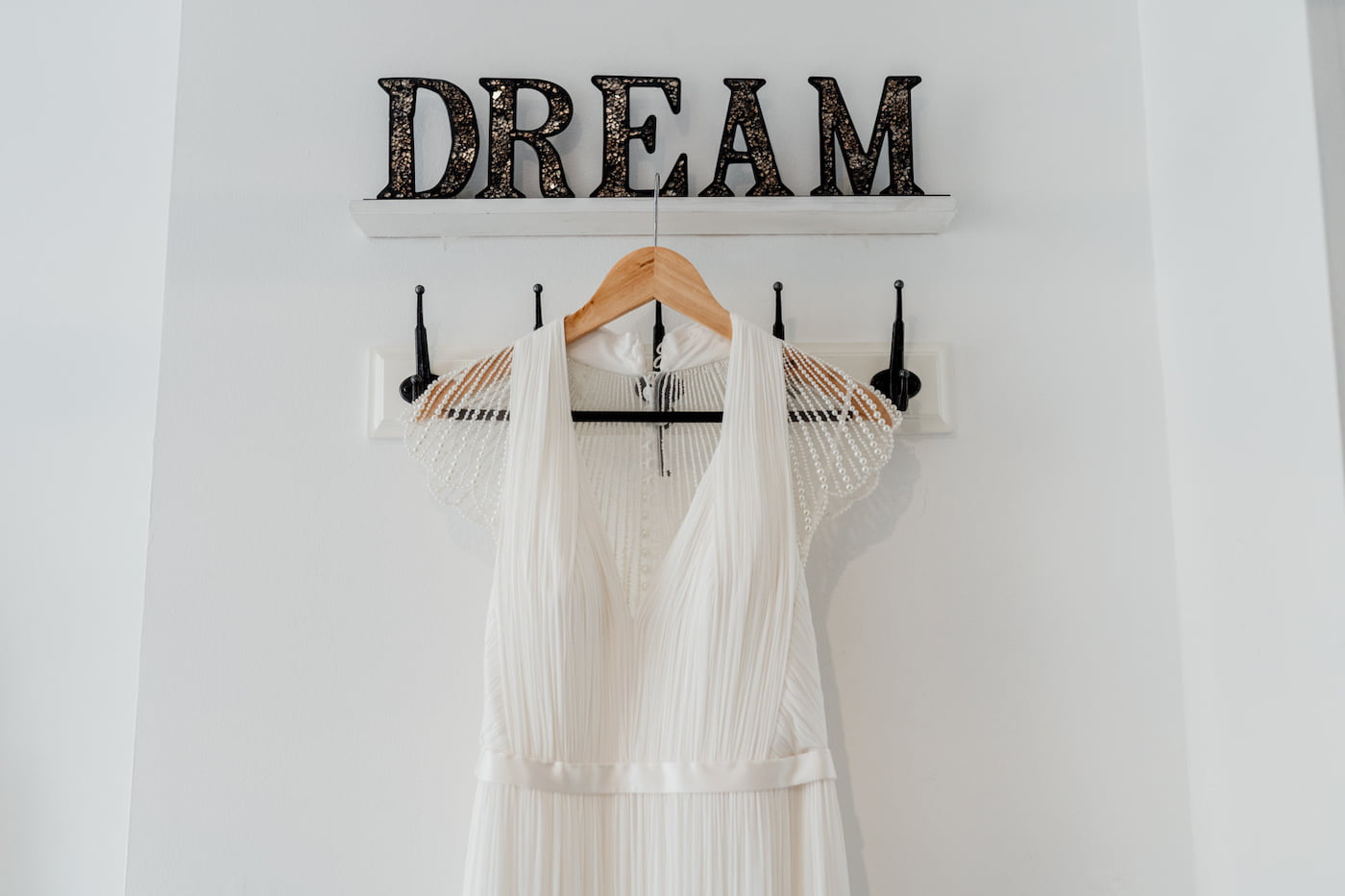 wedding dress hung up