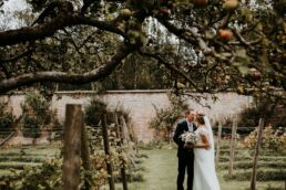 bride and groom kissing in the walled garden