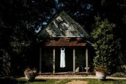 wedding dress hanging outside on building
