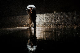 wedding reflection rain photograph of bride and groom