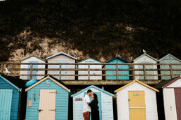 couple kissing on the beach for Devon engagement photoshoot