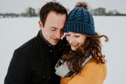 couple together in the snow engagement photoshoot