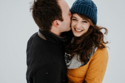 couple smiling in the snow