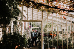 couples engagement photoshoot in greenhouse