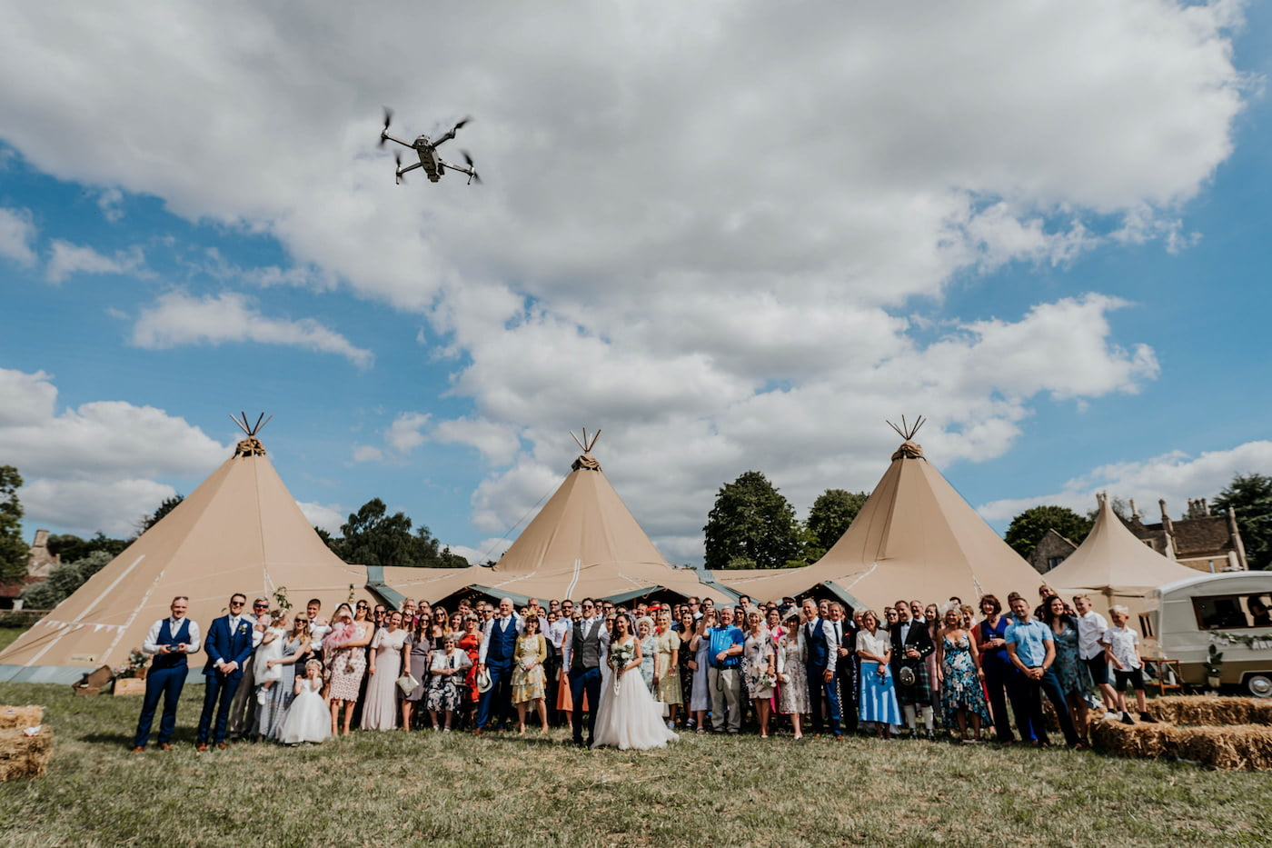 drone taking picture of wedding party