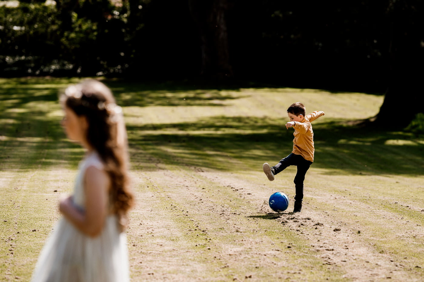 wedding guest playing football