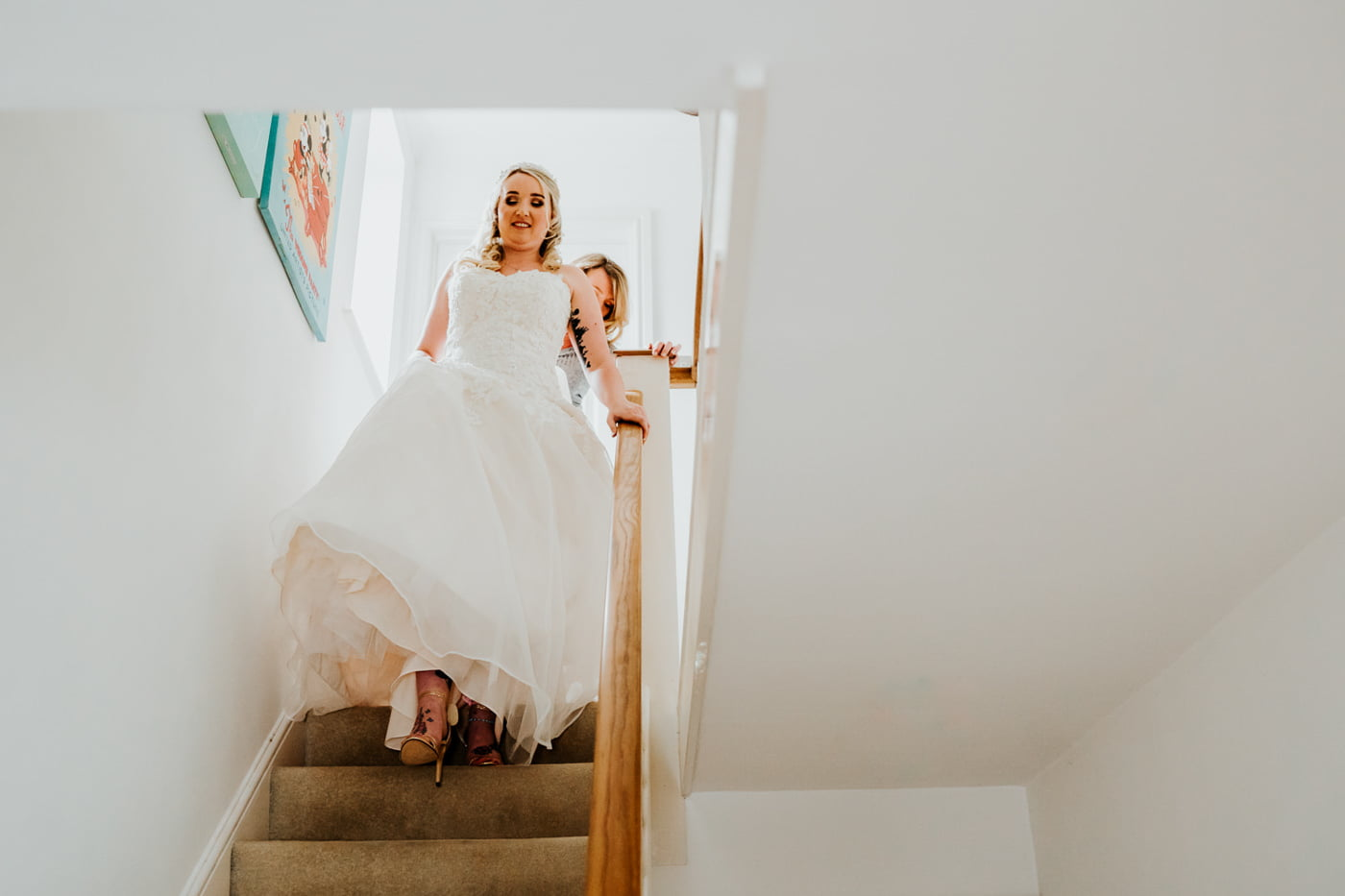 bride walking down the stairs in her dress