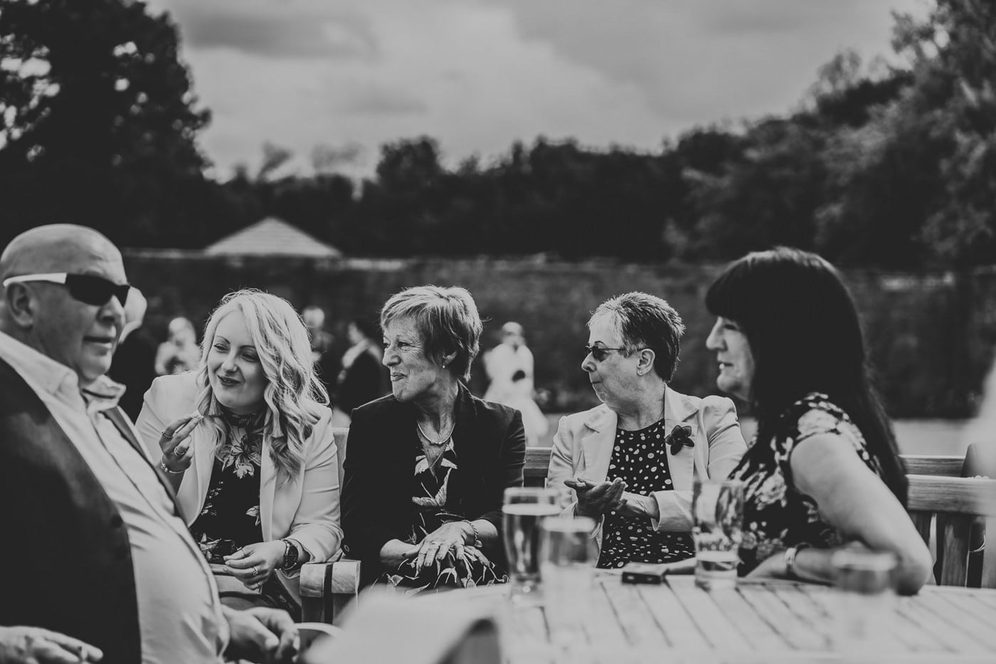 wedding guests laughing together and eating