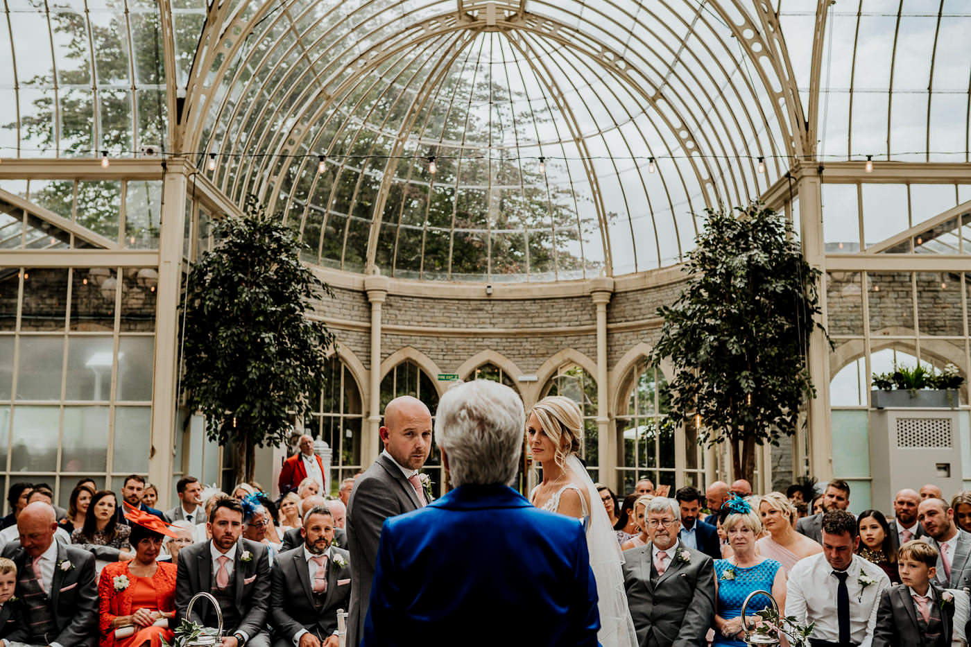 emotional bride and groom during orangery wedding ceremony