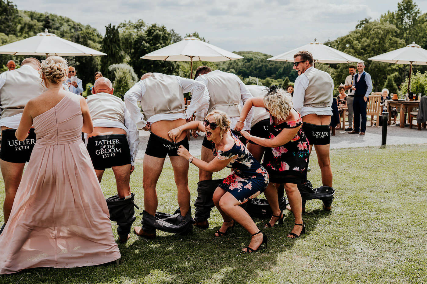 wedding guests putting money down mans pants