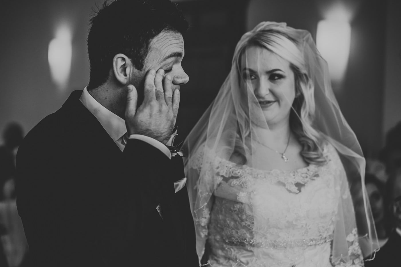 groom wiping tear off his face