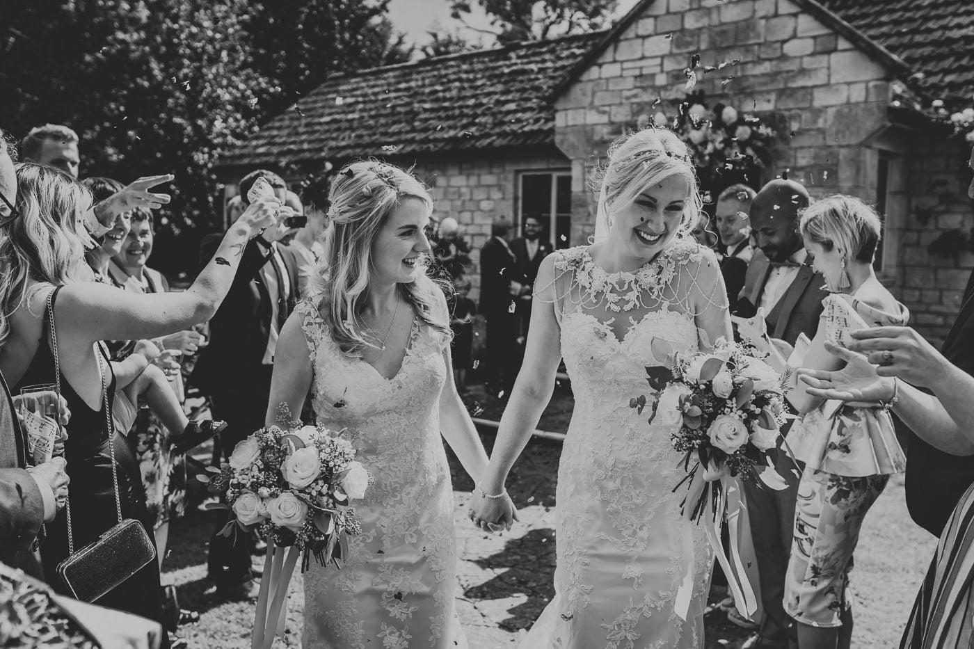 wedding confetti tunnel at same sex wedding