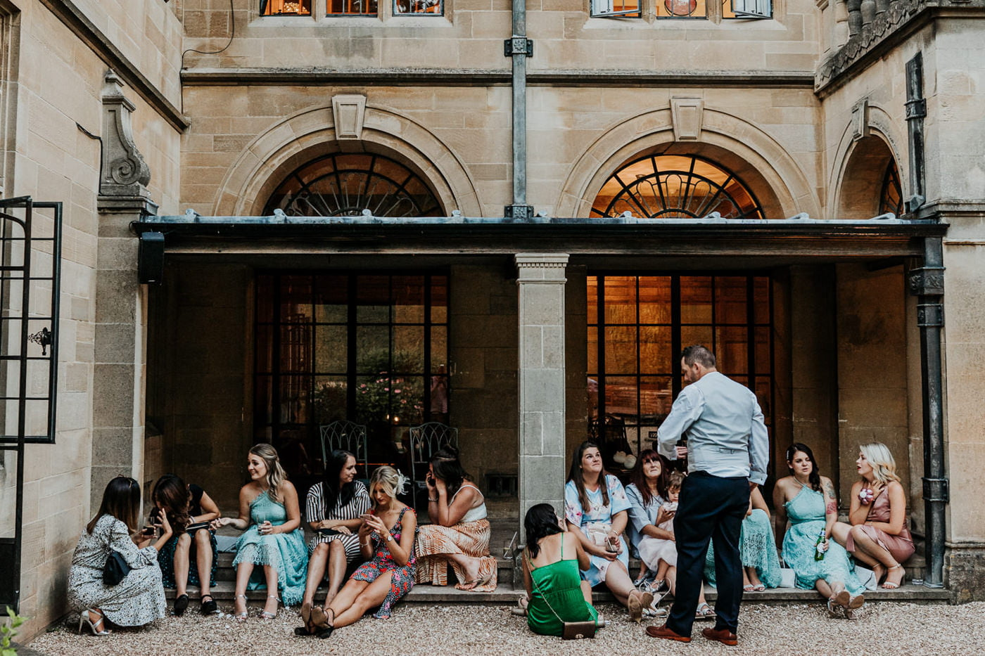 wedding guests relaxing outside