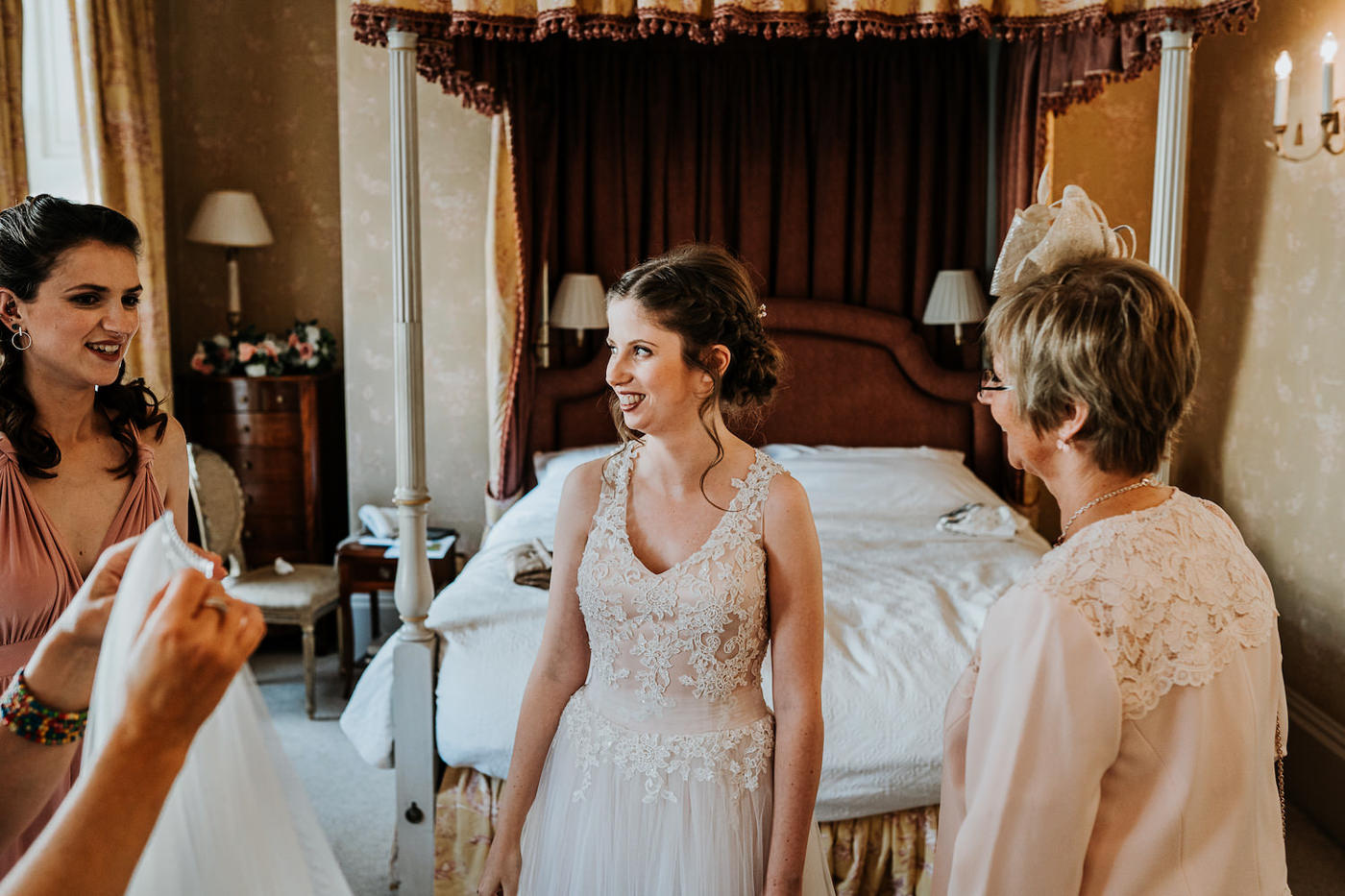 bride smiling with her bridesmaids