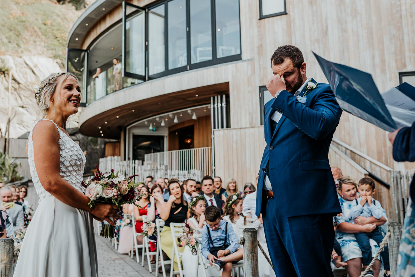 groom getting emotional during wedding ceremony