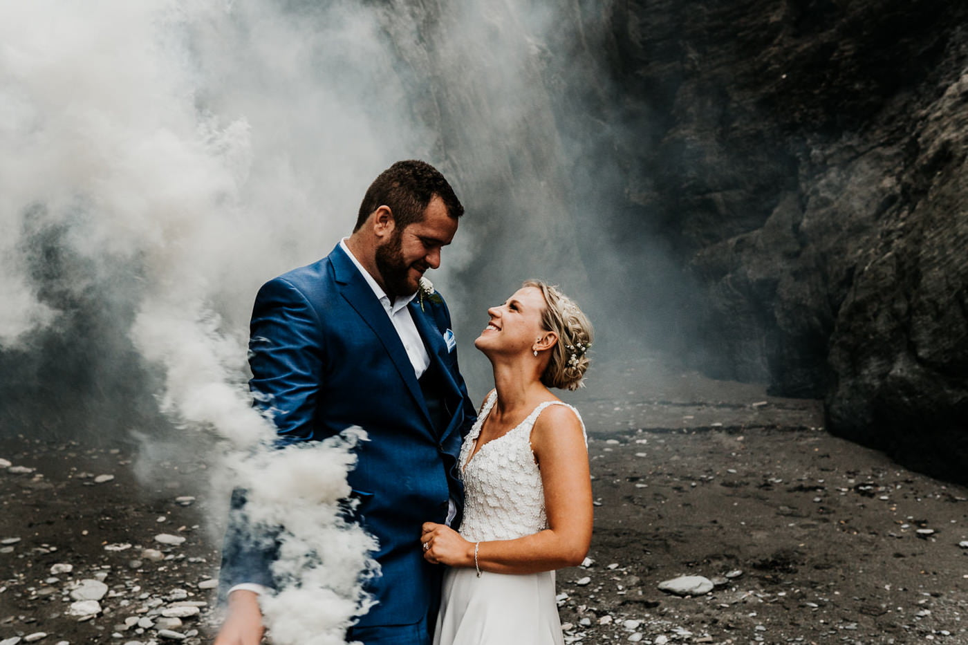 bride and groom with smoke grenades