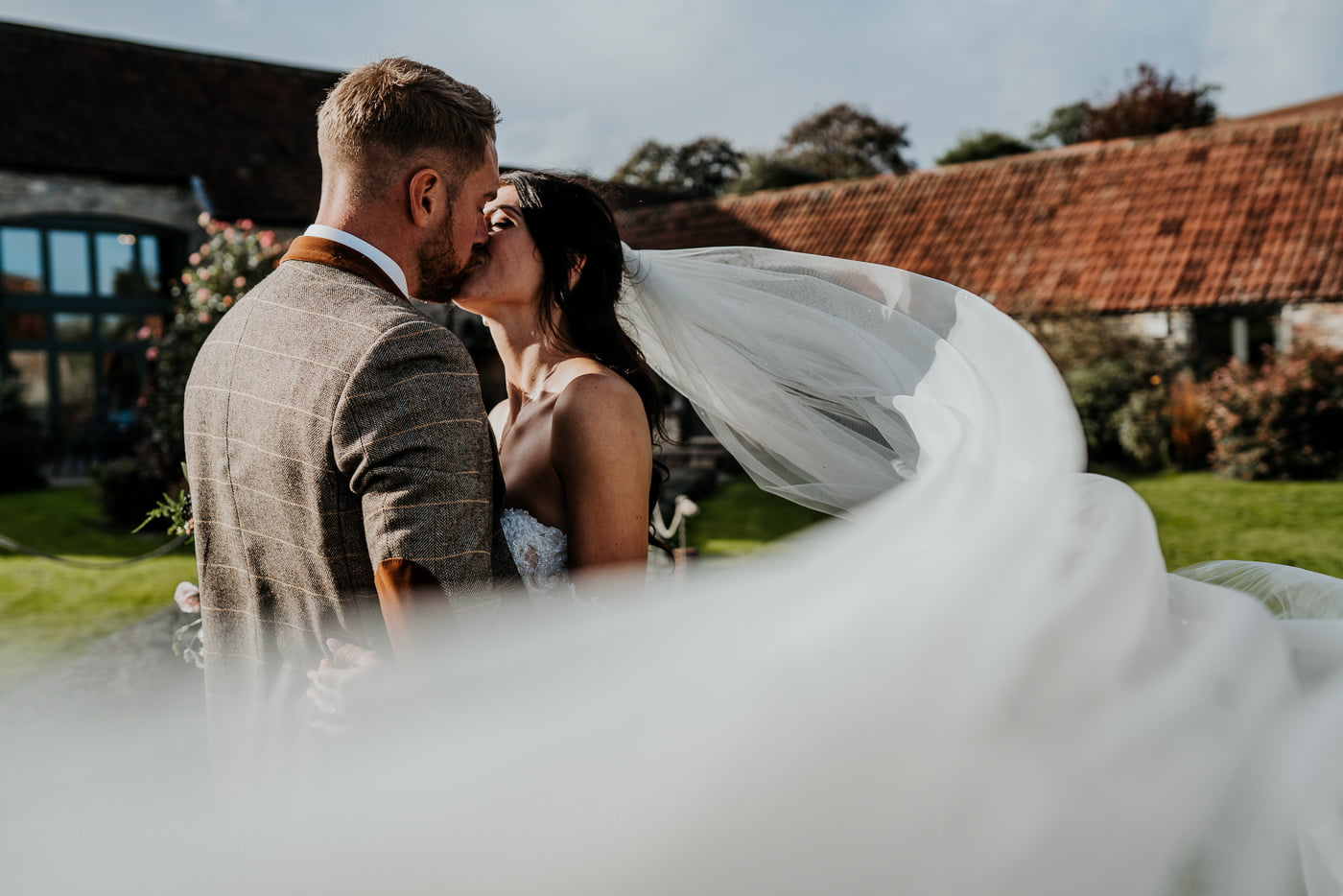 bride and groom with the veil