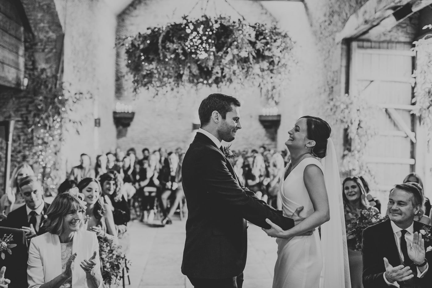 bride and groom at stone barn cotswolds
